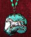 Sterling silver indian pony on turquoise.