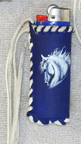 Leather lighter pouch of blue and white deerskin with white stallion.